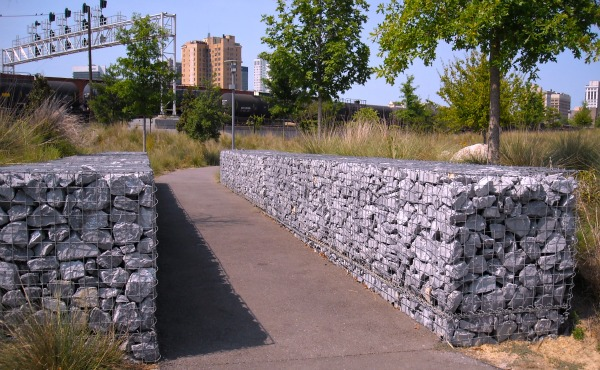Gabion use in landscaping at railroad park for Gabion landscaping