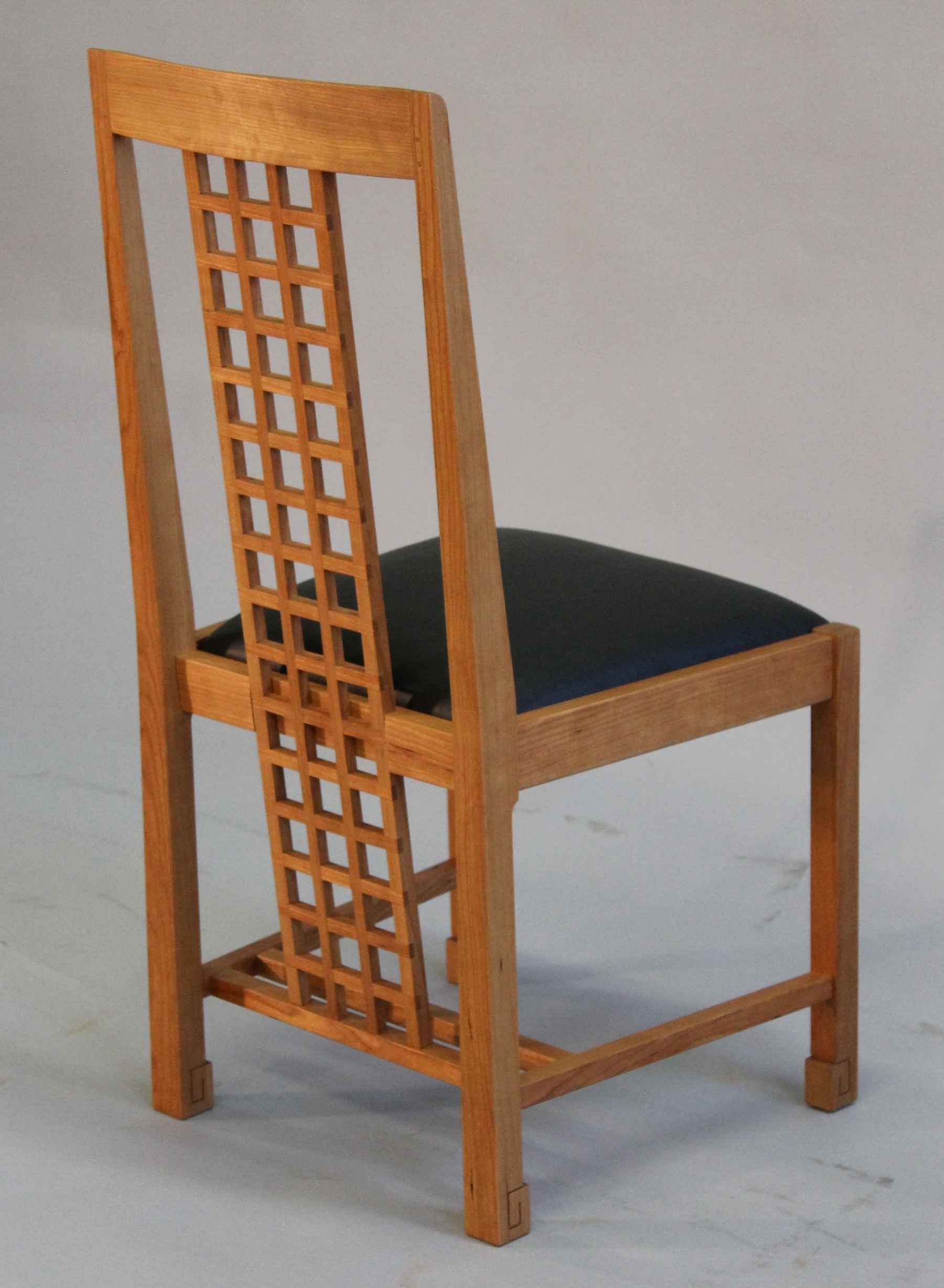 Attrayant Grid Back Dining Chair Showing Full Length Of Lattice Work Back.