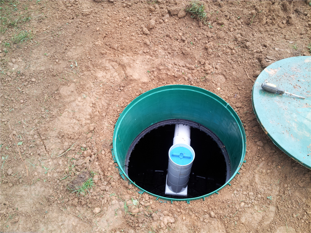 An effluent filter was installed on the outlet baffle of Infiltrator Sepic Tank. This filter will trap debris, hair & grease that would normally be discharged into the disposal area resulting in a possible clogging of the disposal area & reduce the life expectancy of the septic system
