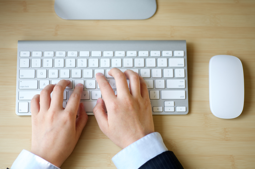 Good Business Email Etiquette image hands typing keyboard
