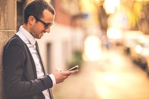 Guy Looking at Smartphone outside_social-media-1.jpg