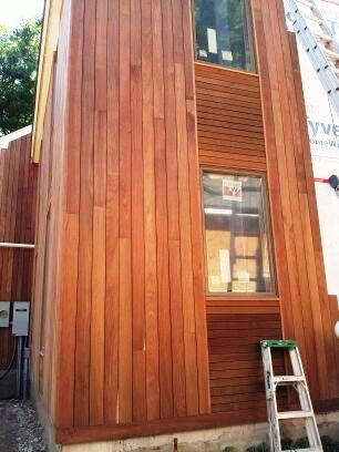 Bold rain screen design combines vertical and horizontal for Horizontal wood siding