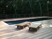 Cumaru pool deck with cumaru furniture and fencing