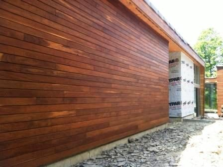 Ipe cladding in Climate Shield rainscreen wood siding installlation