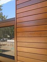 Ipe trim transition strip on Ipe Rain Screen Wood Siding at window detail