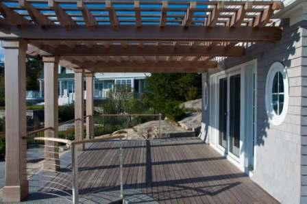 Low maintenance Ipe hardwood decking with pergola and cable rail system