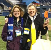 Leslie Vail and Belinda Allen on the Seattle Seahawk football field.