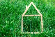 stock-photo-model-house-made-on-green-grass-81485273.jpg