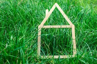 stock-photo-model-house-made-on-green-grass-81485273.jpg