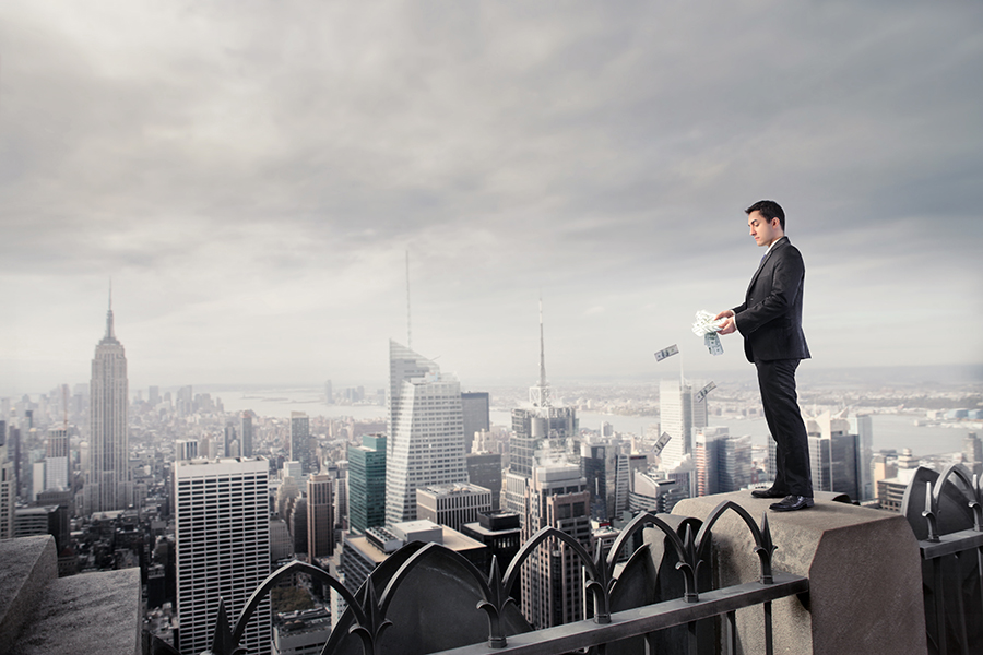 Man overlooking city from a tall building
