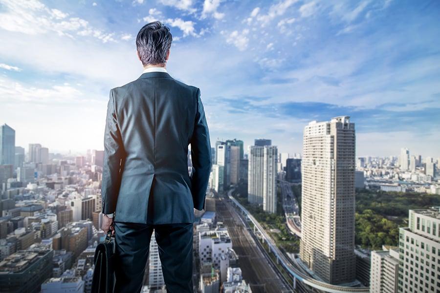 Man overlooking a city of skyscrapers