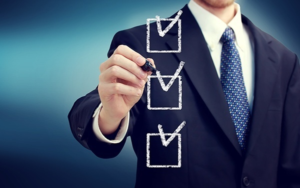 Man checking off middle checkbox of three
