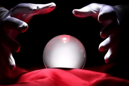 Photo of a mind reader consulting a crystal ball.