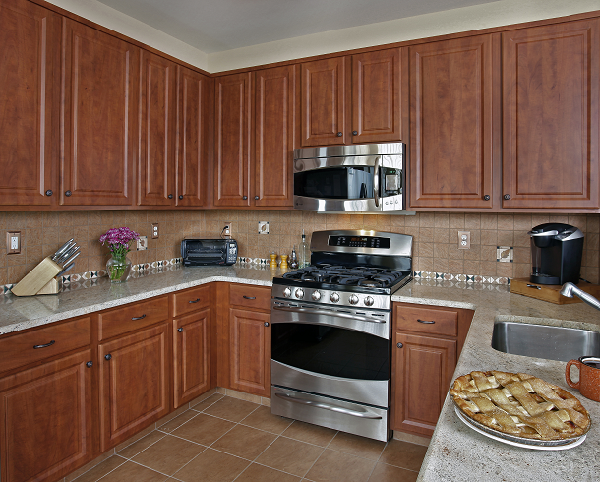 cherry kitchen cabinets with quartz countertop