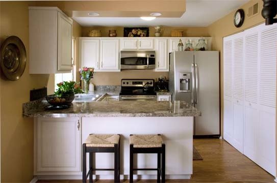 White kitchens 4 ways to make white cabinets work for Small kitchens with white cabinets
