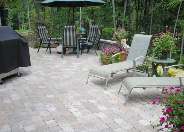 Beautiful paver patio with a sitting wall by bahler brothers in Connectictu
