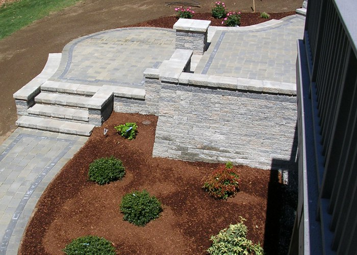 raised paver patio with steps, sitting walls and pillars by bahler brothers in Connecticut