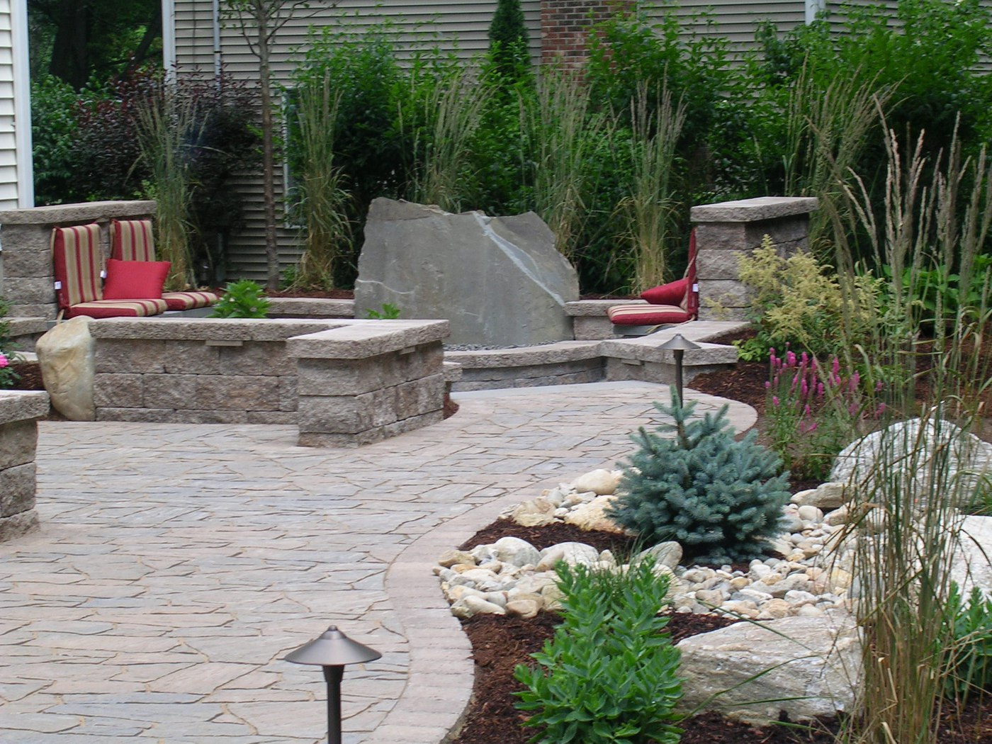 how much does a deck cost vs a paver patio