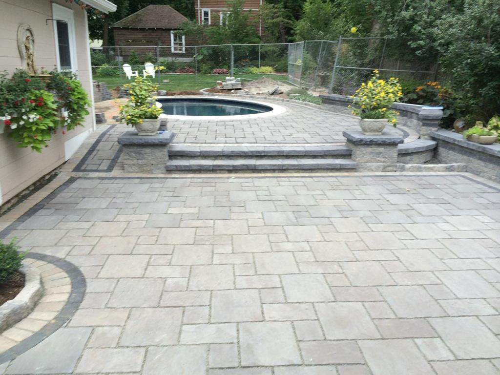 Paver pool patio with steps and retaining walls by Bahler ...
