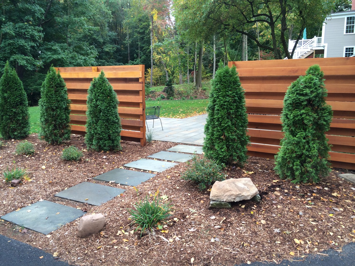 Landscaping Ideas For Cedar Trees : Stones through cedar panels and landscaping by bahler brothers in ct