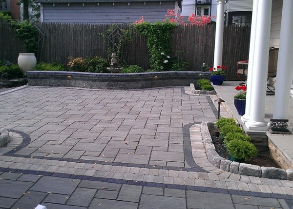 permeable paver patio with a strong black accent band and border by bahler brothers in West Hartford, CT