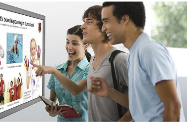 customers at touch screen