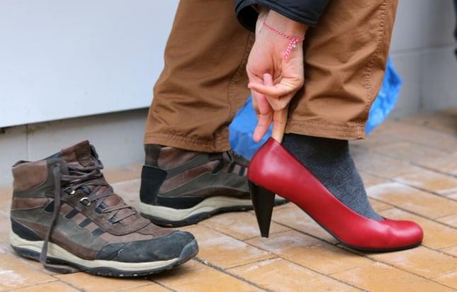 man putting on ladie's high heels