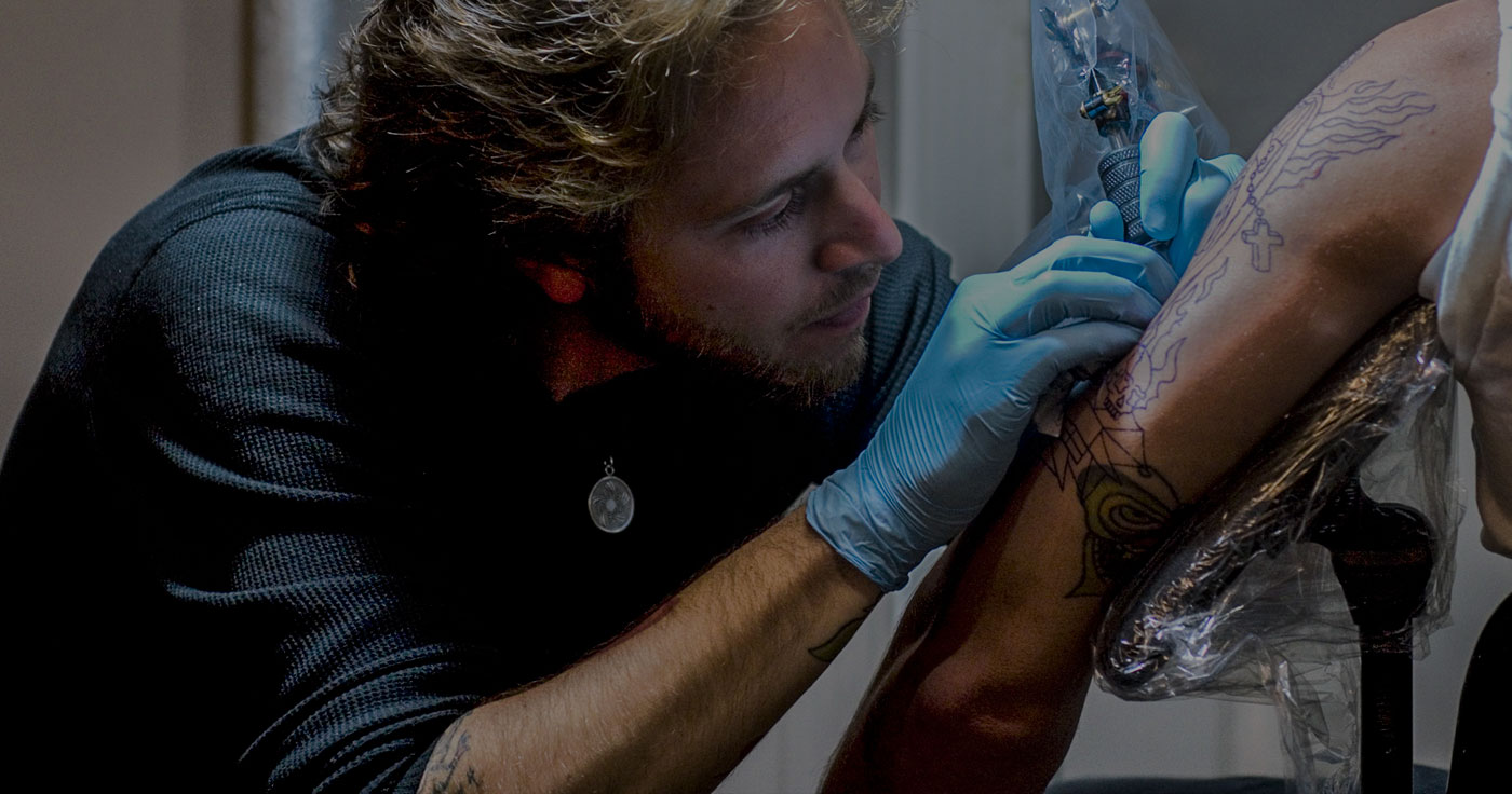 This is graduate tattoo artist, Pete Doty, tattooing his client.