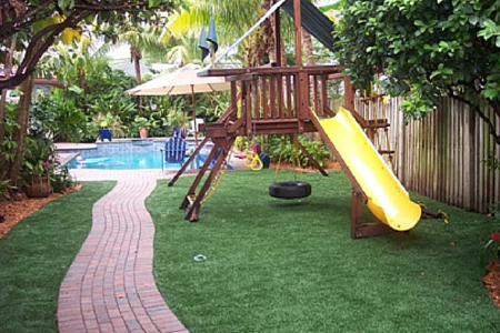 artificial grass in backyard around pool