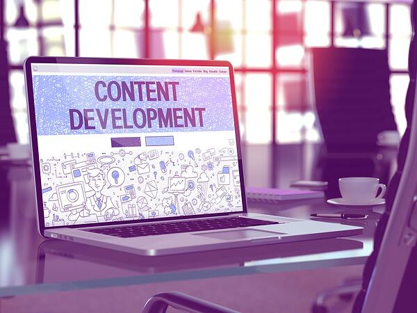 Modern Workplace with Laptop showing Landing Page in Doodle Design Style with text Content Development. Toned 3d Image with Selective Focus.
