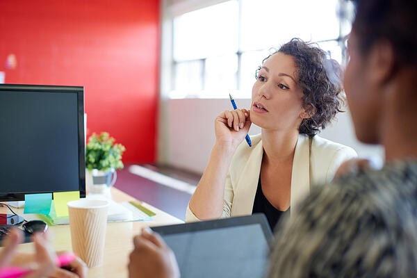Unposed group of creative business people in an open concept office brainstorming their next project.-22