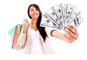 Happy shopping woman with a lot of money - isolated over white_email.jpg