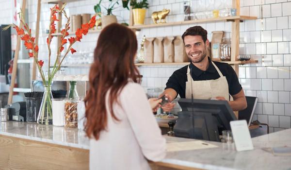 restaurant cashier with customer