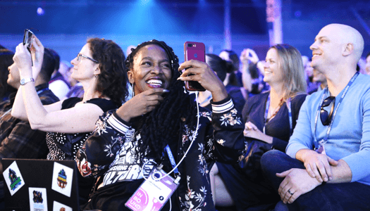 Audience members taking photos at INBOUND