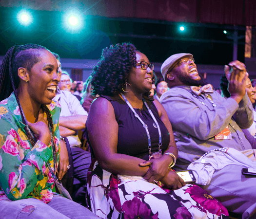 Laughing audience members at INBOUND