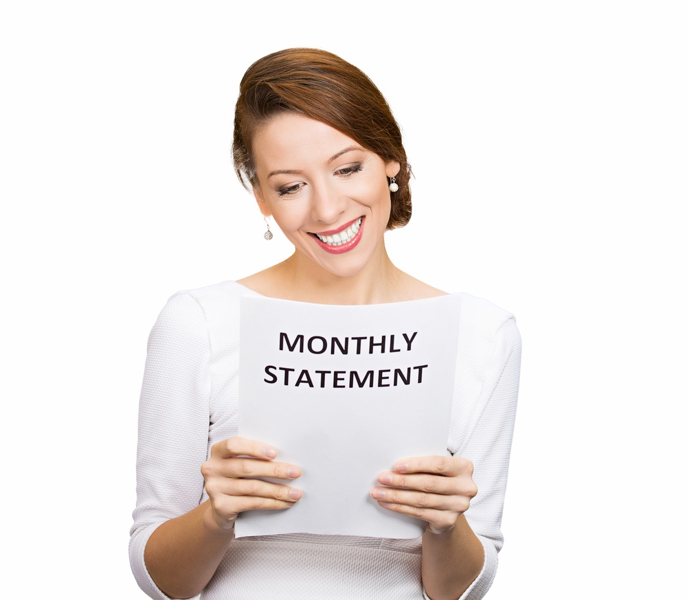 Closeup portrait happy excited young business woman looking at monthly statement glad to pay off bills, isolated white background. Positive emotions, facial expressions. Financial success, good news.jpeg
