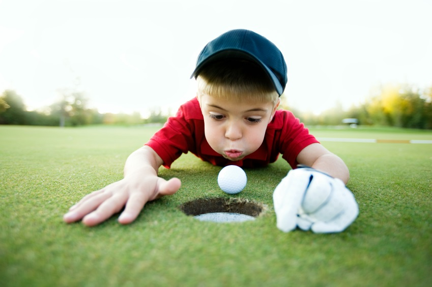 Image result for kid blowing golf ball into the hole