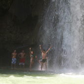 A strong water massage under Kawasan Falls
