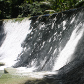 The dam wall at the top of the falls; a spot to relax and meditate in nature