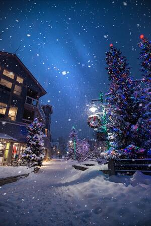 Street decorated in Christmas decorations and snow
