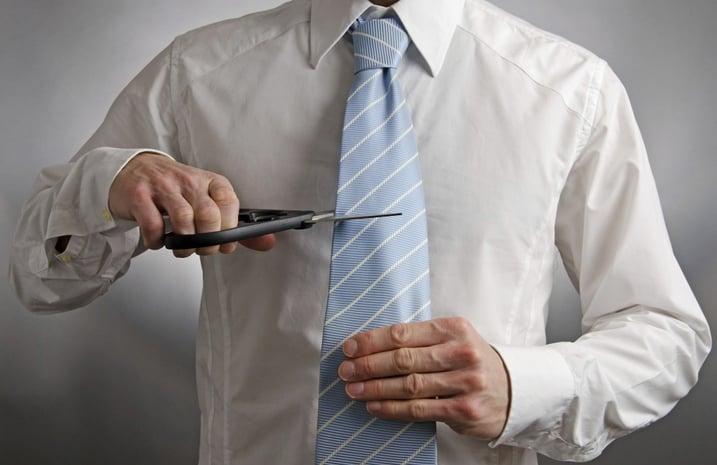 Businessman_Cutting_Ties
