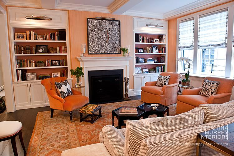 16 chic interiors how to decorate with orange rugs and coral rugs for Black and burnt orange living room