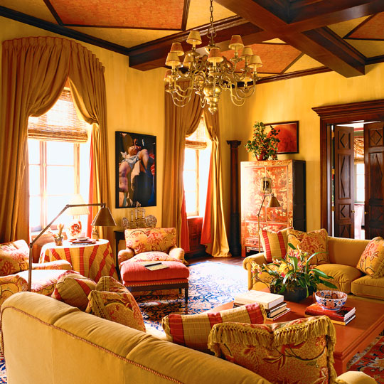 12 dazzling interiors with decorative rugs in red yellow for Orange and yellow living room ideas