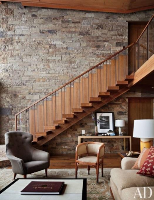 gold-rug-spanish-oriental-rug-mountain-home-living-room-staircase-Studio-Sofield.jpg