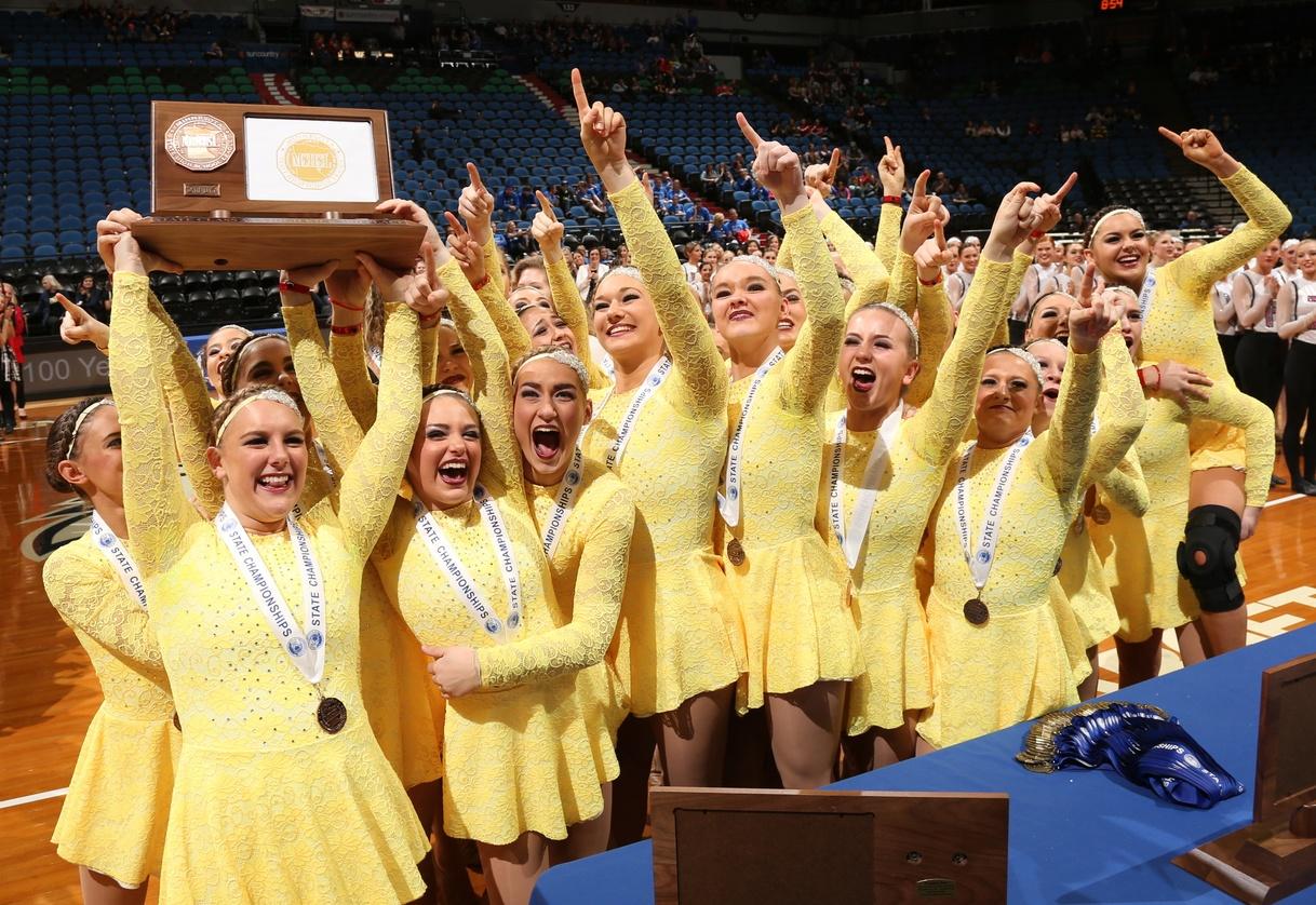 Chaska High School in custom yellow high kick dresses