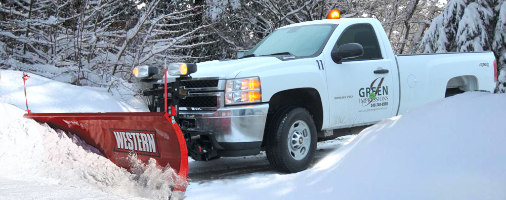 Residential snow removal and plowing services by Green Impressions Landscaping