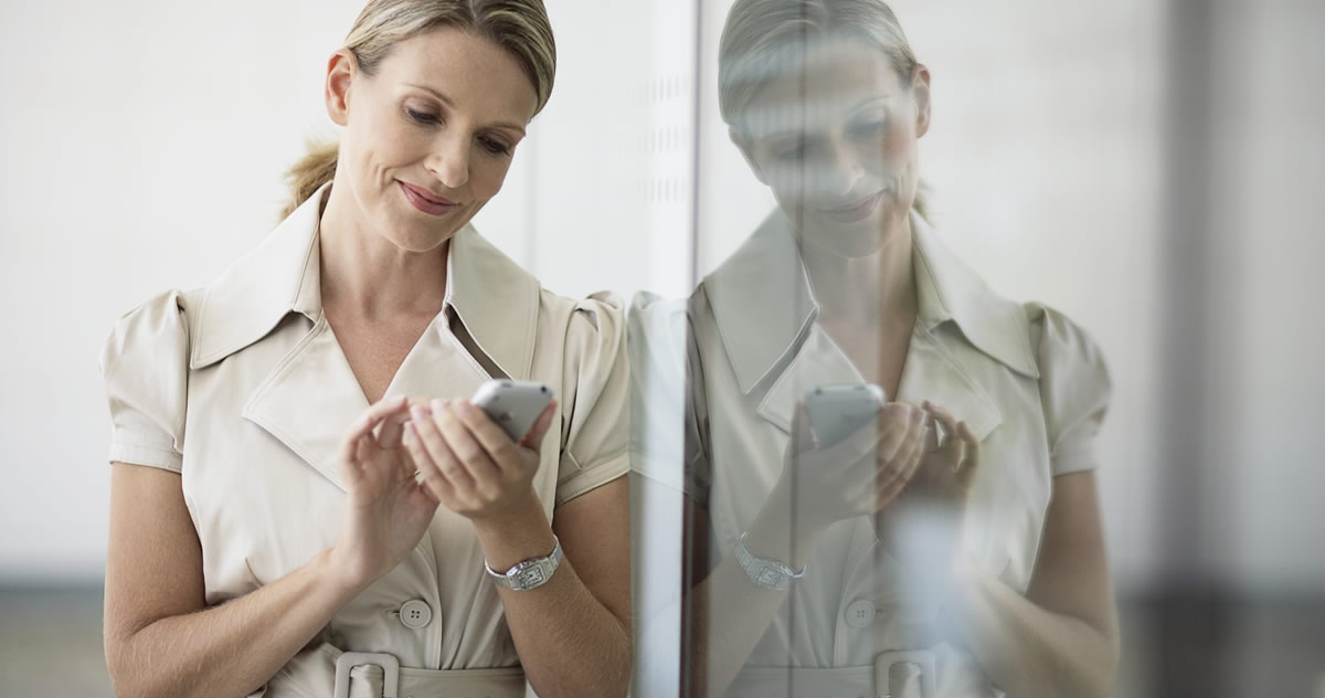 Women on smartphone Accessing HR information