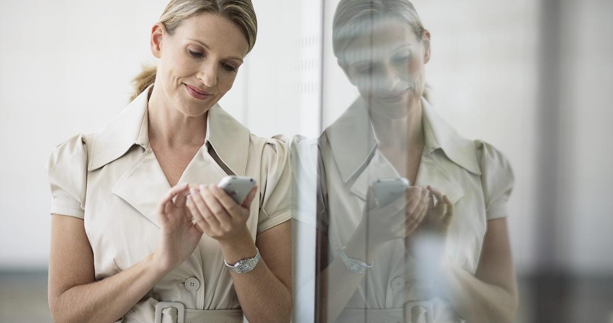Women on smartphone Accessing HR portal information