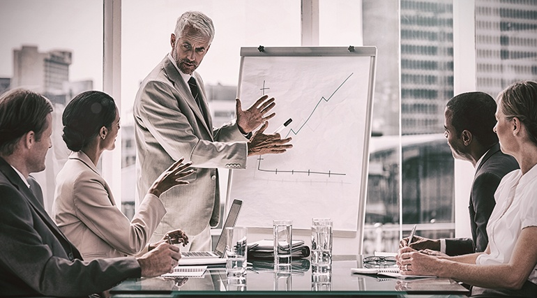 Businessman discussing about enterprise mobility during a meeting