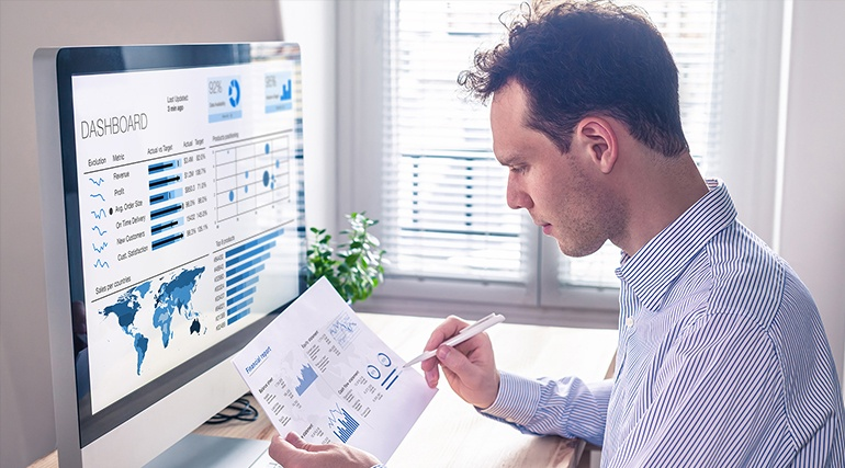 Project manager going through the Intelligent automation dashboard
